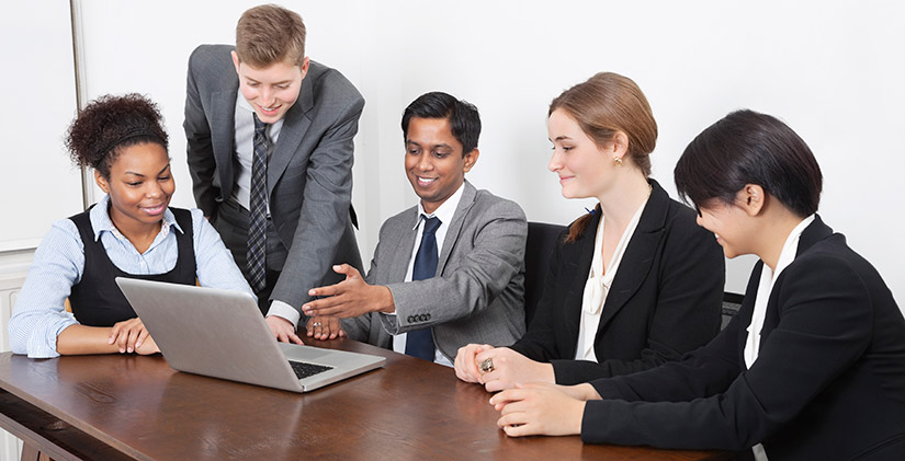 Five business people around a laptop
