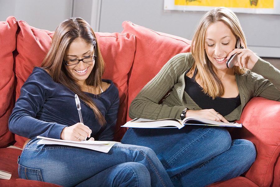 Two Students Sitting on a Couch