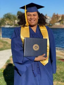 Angelica Dailey with diploma