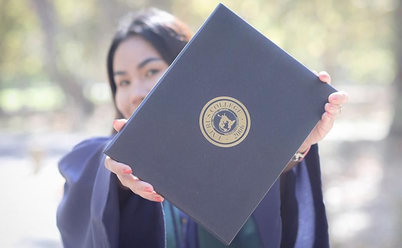 Riza Monaya Holding a Diploma