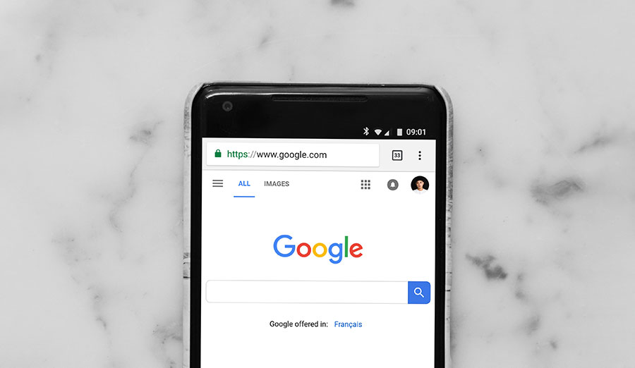 A mobile phone showing the google homepage