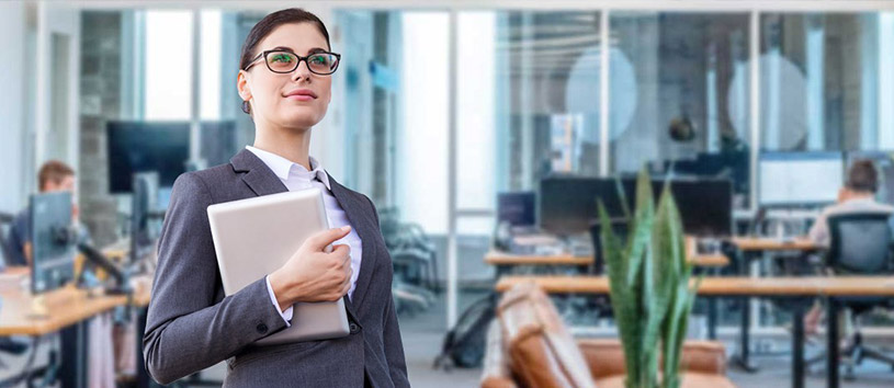 Woman holding a binder in an office setting