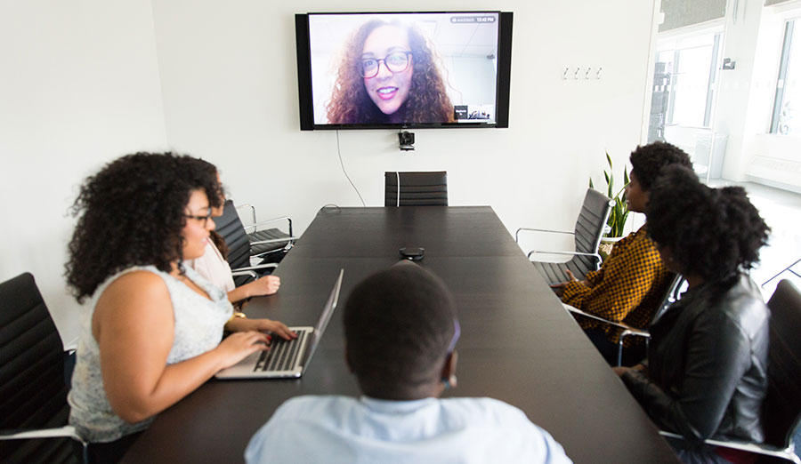 People in a video conference in a conference room