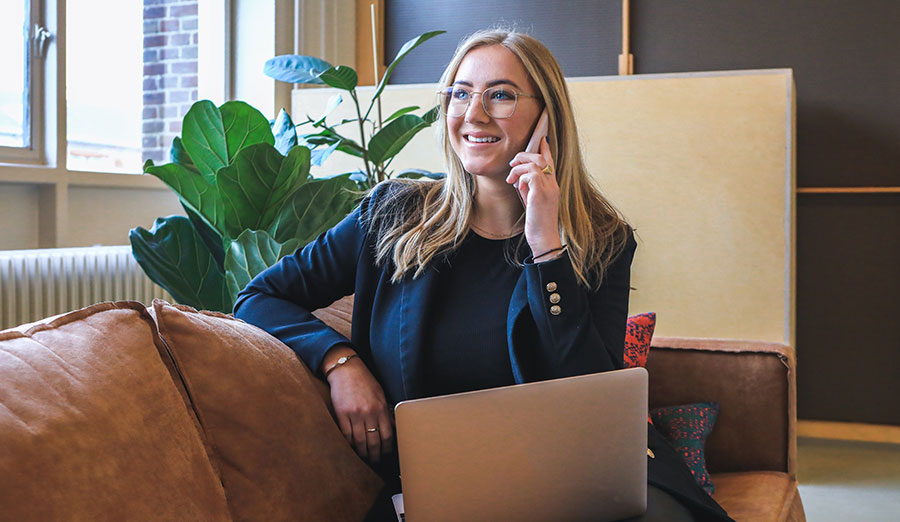 Professional looking woman on phone with laptop
