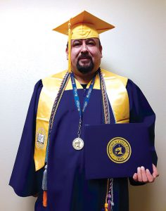 Roger Reyes wearing a cap and gown