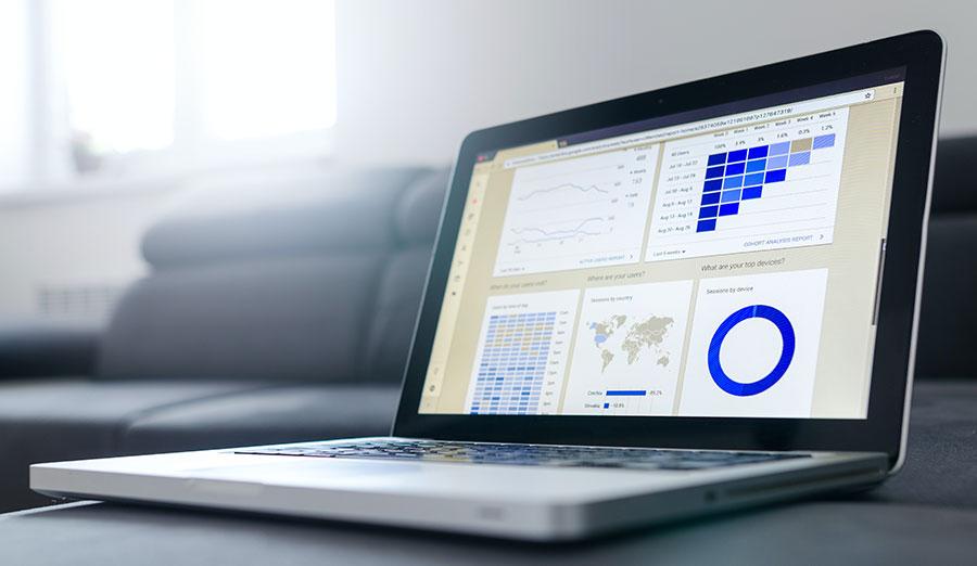 A laptop showing various metrics