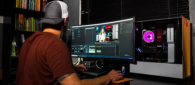 Man editing at a workstation for audio video production