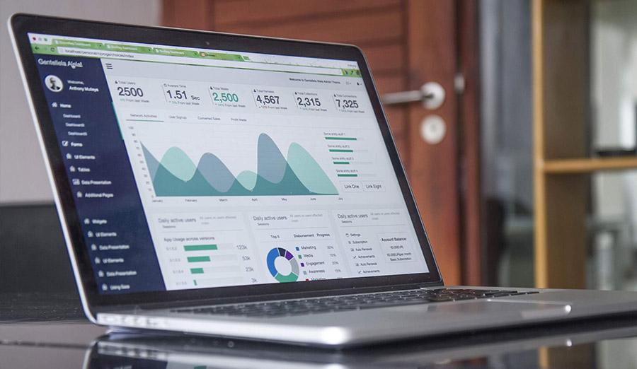 laptop showing various metrics