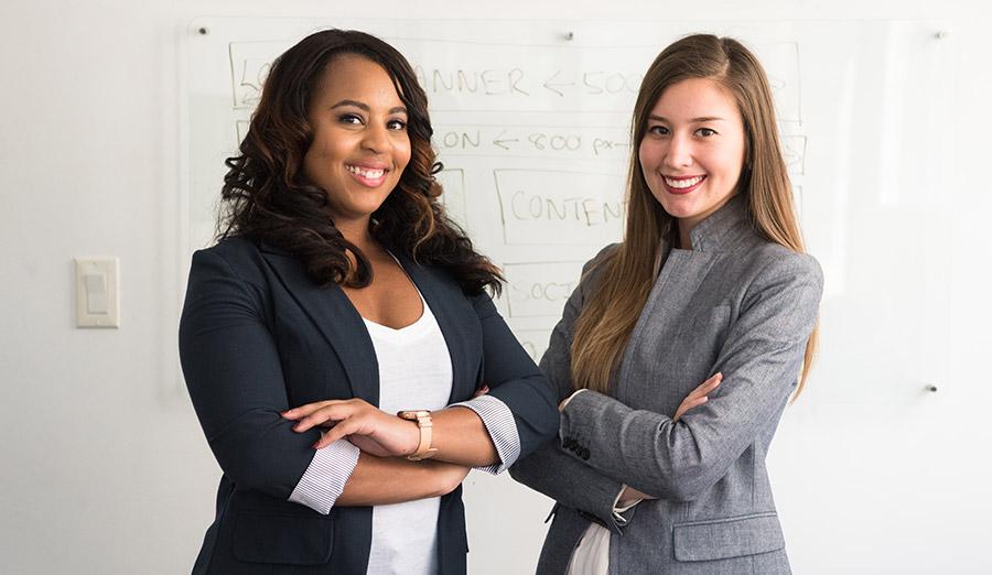 Two women in professional dress