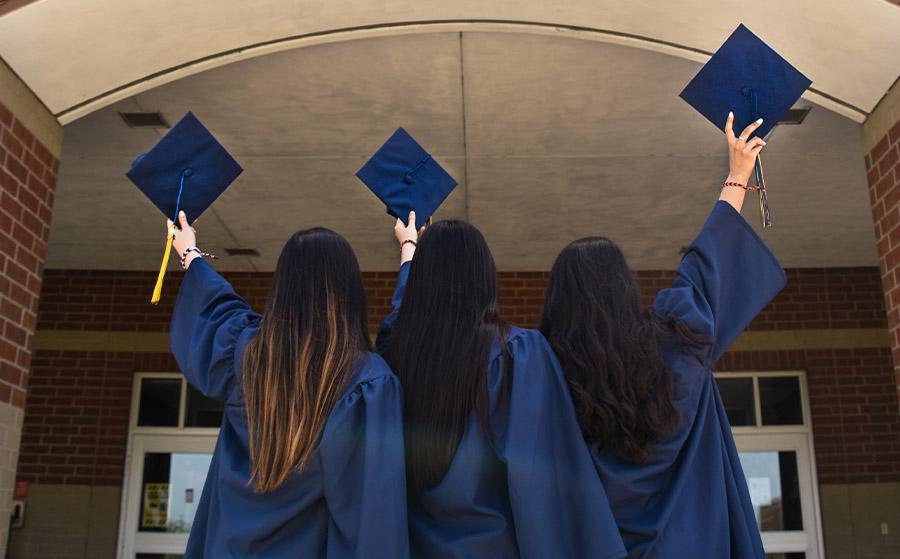 Three women in graduation gowns