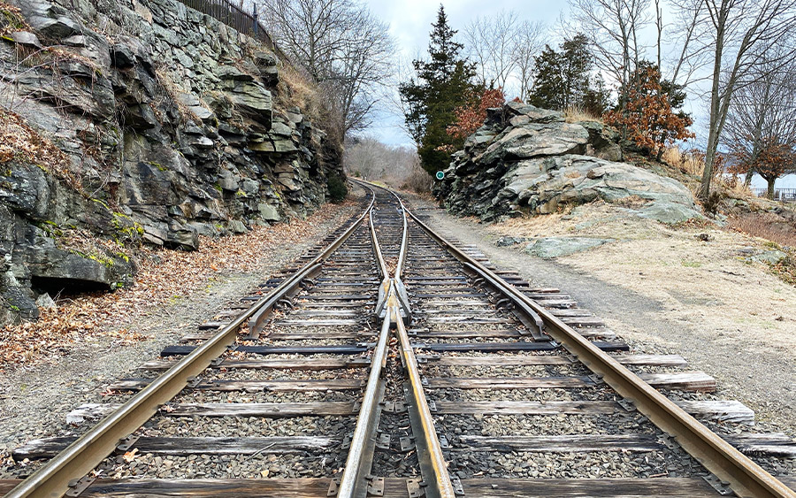 Two train tracks converging