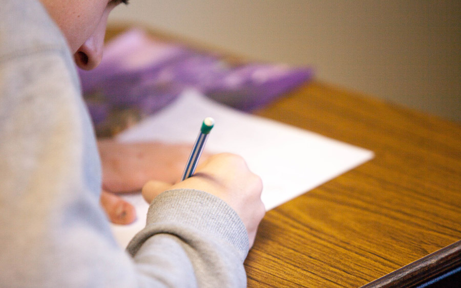 Person taking a test with a mechanical pencil
