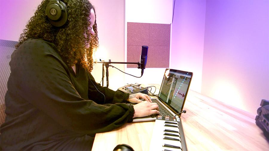 Monica wearing headphones at desk